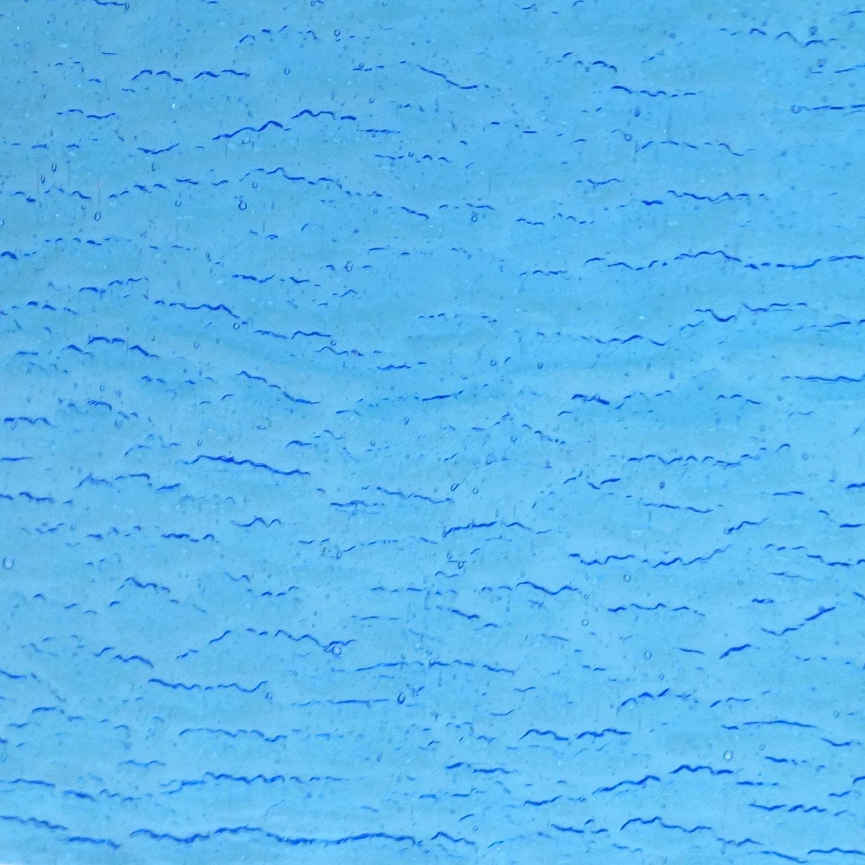 Kokomo Pale Blue Turquoise Transparent Rolled Granite