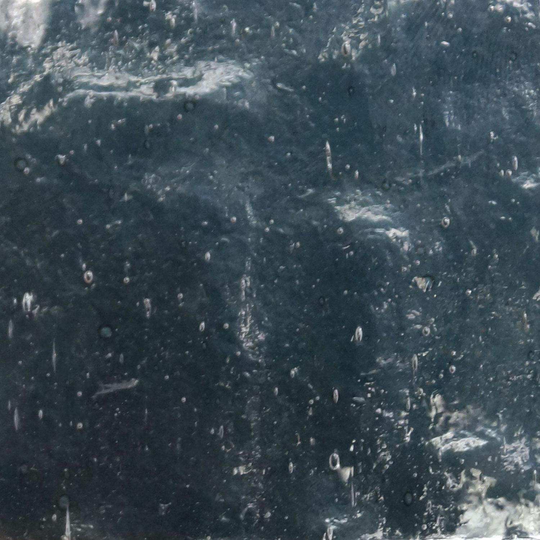 Kokomo Blue Gray Transparent Rolled Granite